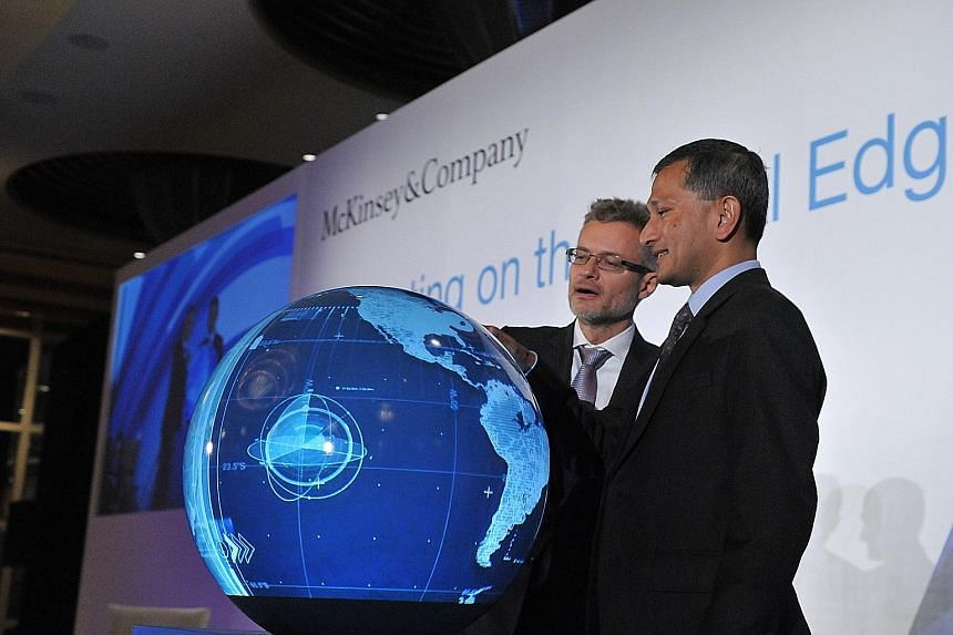 Foreign Minister Vivian Balakrishnan and Mr Oliver Tonby, managing partner for South-east Asia at McKinsey & Company, launching the McKinsey Digital Campus at the 9th McKinsey Innovation Forum yesterday.