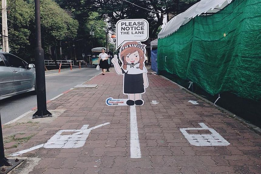 """Touted as the first in Thailand, a """"mobile phone lane"""" has been launched on a trial basis at Kasetsart University (KU) in Bangkok to separate pedestrians who must use their phones while walking from those who are in a rush. The dual-lane footpath is"""