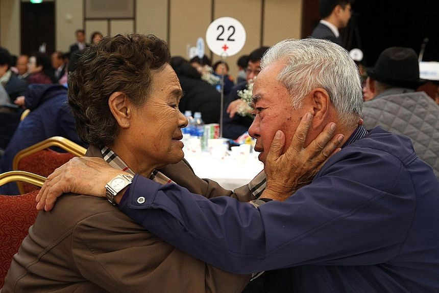 Mr Lee Cheon Woo, from South Korea, and his sister Ri Mun Woo, from North Korea, bidding farewell yesterday after an emotional three-day family reunion at the Mount Kumgang resort on the North's south-eastern coast. The mass event, which involved som