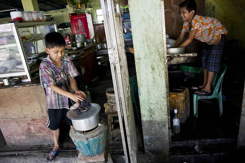 Children working in a tea shop on the outskirts of Yangon. In Myanmar, child workers often toil 14 hours a day, seven days a week. The country is the world's seventh worst for child labour, just ahead of India and Liberia.