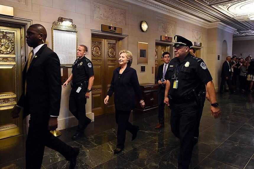 Former secretary of state and Democratic Presidential hopeful Hillary Clinton arriving to testify before the House Select Committee on Benghazi on Capitol Hill in Washington, DC yesterday.