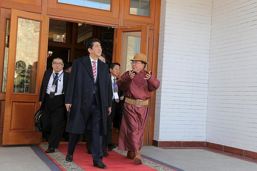 Mr Abe with Mongolian President Tsakhiagiin Elbegdorj during their meeting at the presidential palace in Ulan Bator yesterday.