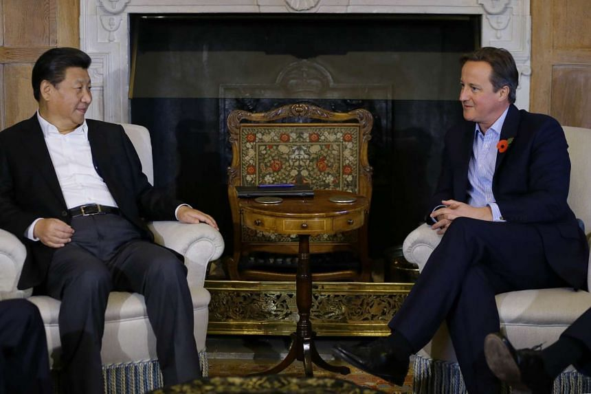 British Prime Minister David Cameron (right) and Chinese President Xi Jinping hold talks at Chequers, the Prime Minister's official country residence, near Ellesborough, on Oct 22, 2015.