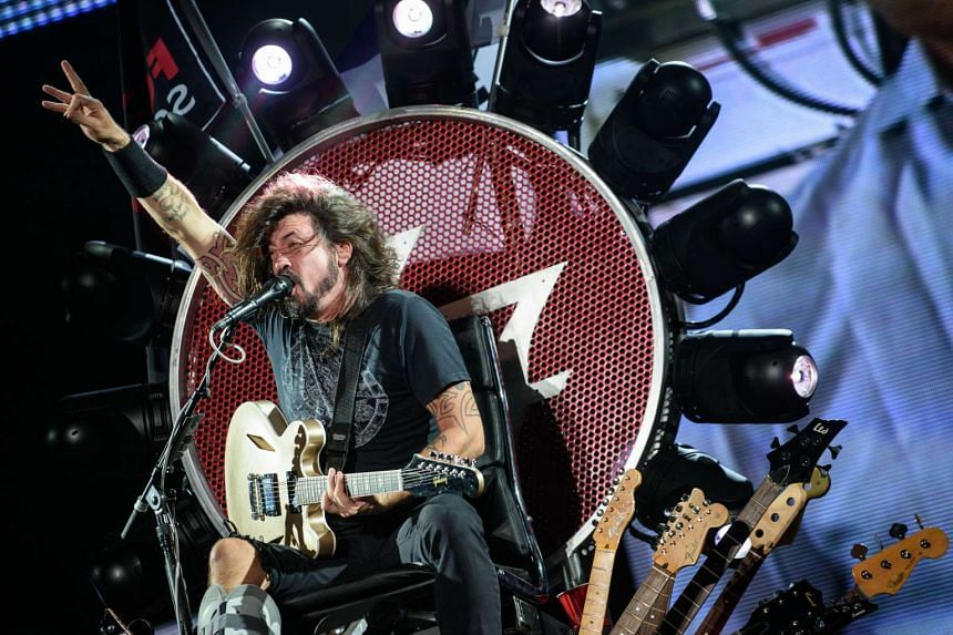 Dave Grohl of the band Foo Fighters performs at the Ansan Valley Rock Festival in Ansan, south of Seoul on July 26, 2015.