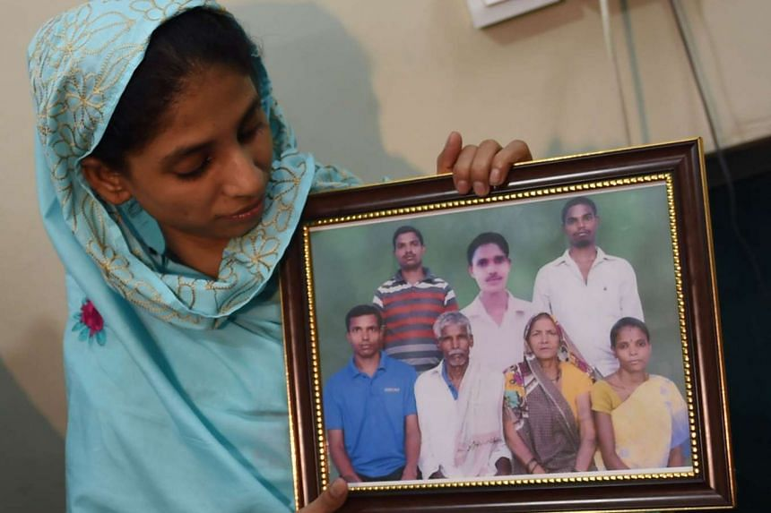 Geeta holds a photograph, possibly of her family, at the Edhi Foundation in Karachi on Oct 15, 2015.