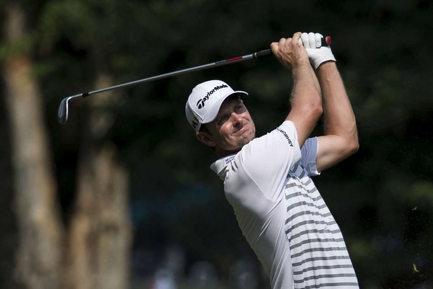 Justin Rose of England hits a shot on the seventh fairway during the first day of the Hong Kong Open golf tournament in Hong Kong, China Oct 22, 2015.