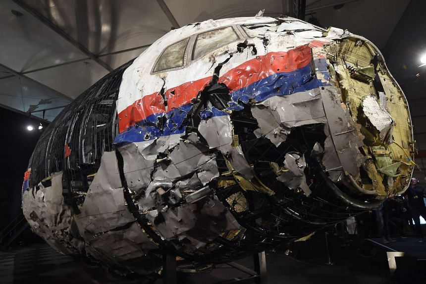 The wrecked cockipt of the Malaysia Airlines flight MH17 is presented to the press during a presentation of the final report on the cause of the its crash at the Gilze Rijen airbase Oct 13, 2015.