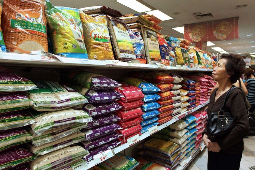 A shopper looks at bags of rice on sale at a supermarket in Petaling Jaya in 2011.