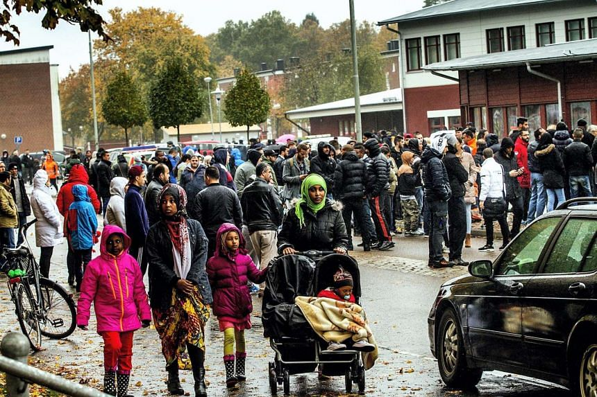 People and parents leaving school after the attack at a primary and middle school in Trollhattan, southwestern Sweden.