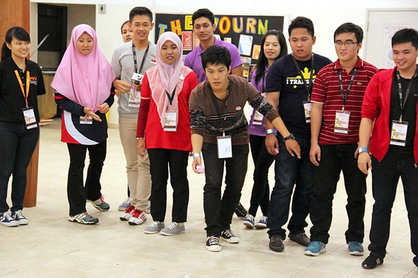 Students from the Asean member states having fun at Singapore Polytechnic's 2014 Youth Model Asean Conference. The polytechnic is the national winner of the inaugural Asean People's Award for organising this conference and its other efforts at region