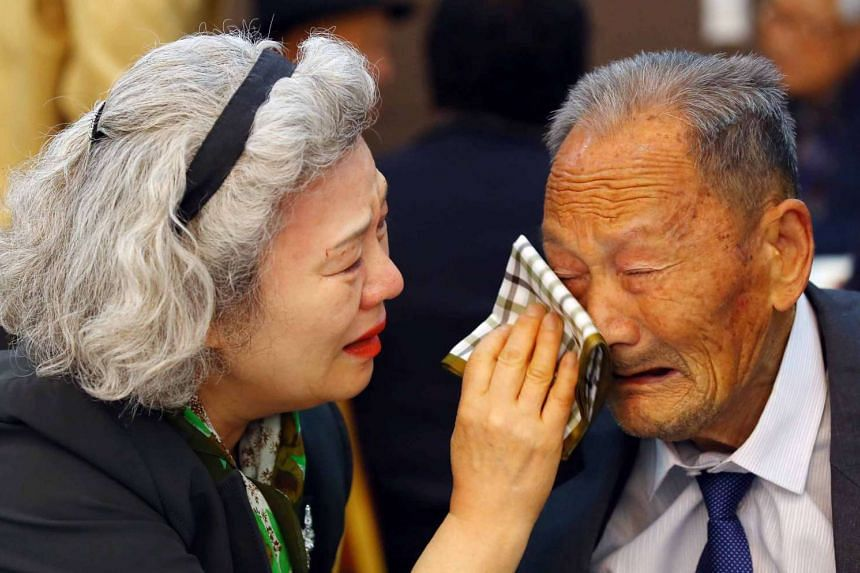 South Korean Lee Jeong Sook, 68, and her North Korean father Ri Hong Jong, 88, in tears at the resort yesterday.