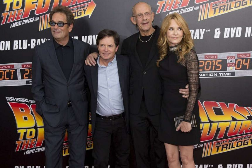 Back To The Future stars (from far left) Huey Lewis, Michael J. Fox, Christopher Lloyd and Lea Thompson at the 30th anniversary screening of the 1985 film in New York on Wednesday, which was Oct 21, 2015. That was the day Marty McFly (Fox) and Doc Br