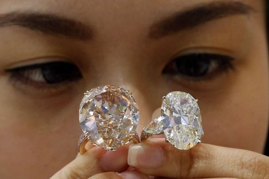 A visitor checking out a 33-carat diamond ring and a 20-carat diamond ring (far right) at the Singapore Jewellery & Gem Fair 2015, held at the Sands Expo and Convention Centre till Sunday. Admission is free.