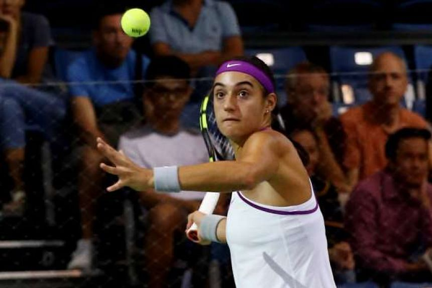 Caroline Garcia (above) started the opening day of the WTA Rising Stars Invitational tournament on a victorious note. Here the Frenchwoman is powering a forehand on her way to beating Japan's Naomi Osaka  (4-1, 1-4, 4-1) in their round-robin match held ye