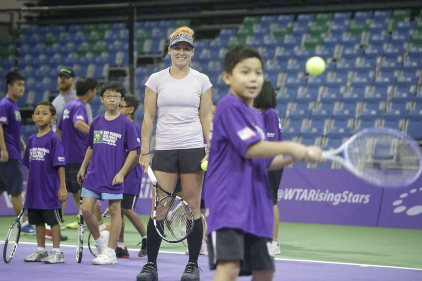World No. 3 doubles player Bethanie Mattek-Sands looking on as kids practise during a Women's Tennis Association clinic at the OCBC Arena on Oct 24, 2015.