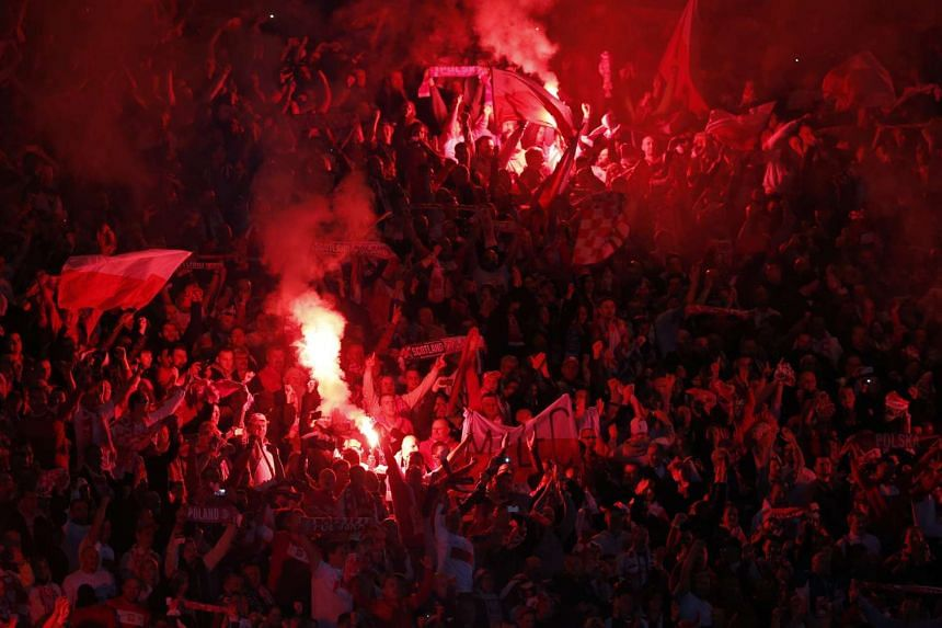 Polish fans lit up fireworks in the 2-2 draw.