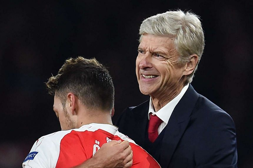 Arsene Wenger congratulating Mesut Oezil on scoring against Bayern Munich in the Champions League on Oct 20.