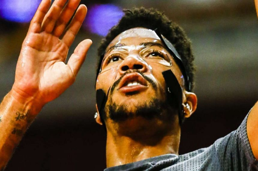 Derrick Rose warming up wearing a clear protective mask before the start of a pre-season game against the Indiana Pacers on Oct 20, 2015.