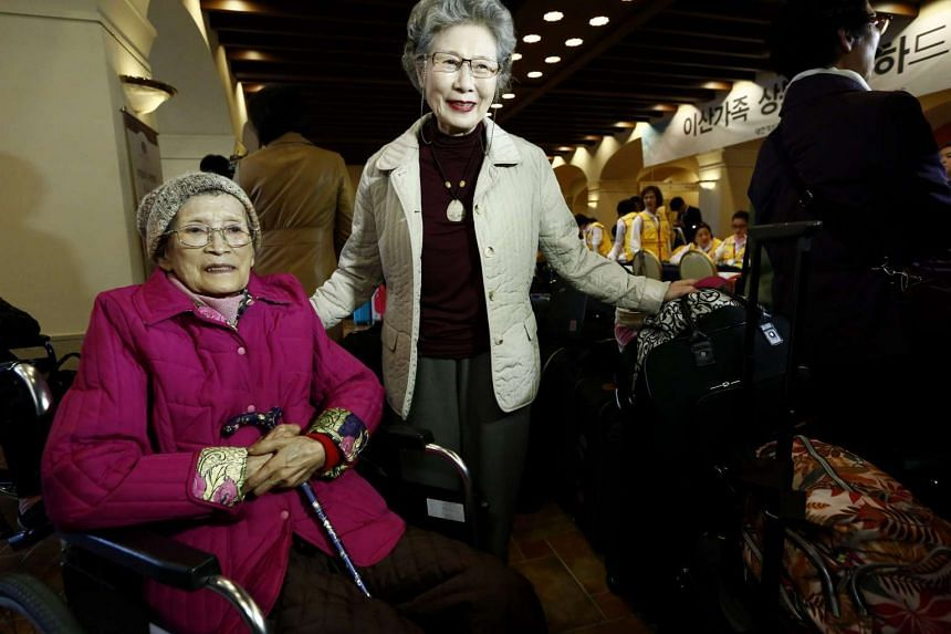 South Korean resident Han Won Ja, 93, (left) arrives to go to North Korea to meet his brother Han Chang Gill, 82, at Hanwha resort in Sokcho, South Korea, on Oct 23, 2015.