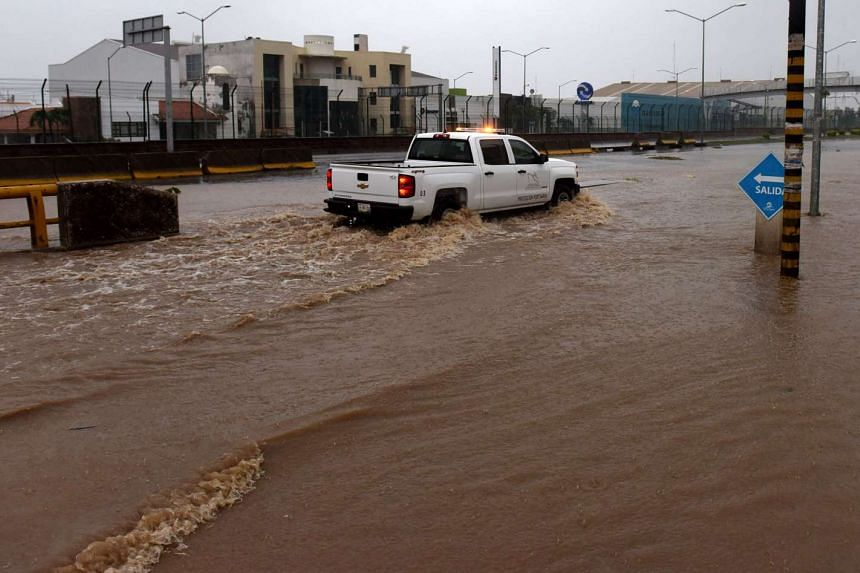 A truck driving along a flooded street in Manzanillo, Mexico, on Oct 23, 2015, during hurricane Patricia.