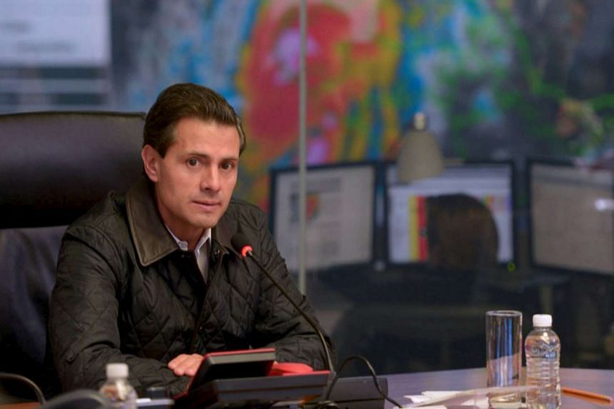 Mexico's President Enrique Pena Nieto leading a meeting with members of the government as a satellite image of Hurricane Patricia is displayed on a screen, on Oct 23, 2015.