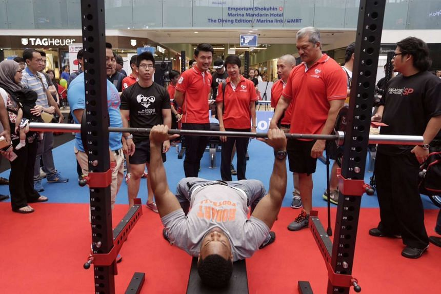 Mr Baey Yam Keng with national powerlifters at the APG Unified Powerlifting Challenge at Marina Square on Saturday.