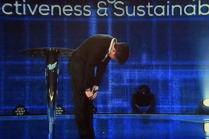 """Onstage at the Suntec Convention Centre, Kong Hee took a deep bow, and said: """"Pastor is sorry."""""""