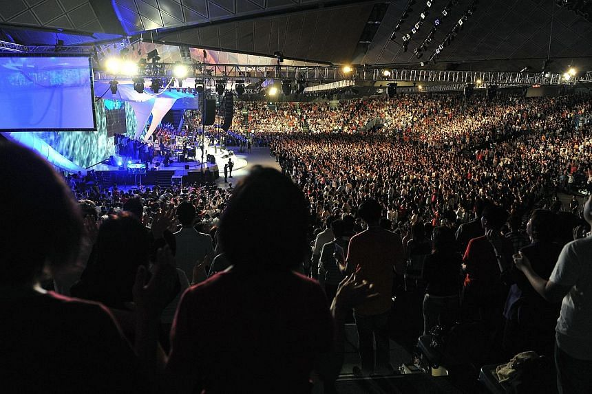 The church's congregation has gone from 23,565 in 2009 to 17,522 last year. (Left) A City Harvest Church service held on March 19, 2011 at Suntec convention centre.