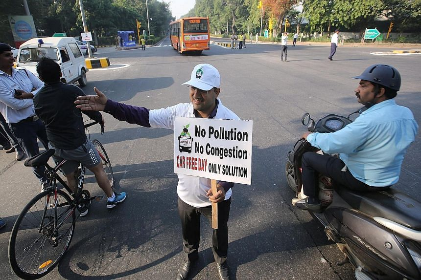 A volunteer taking part in a cycle rally to mark the first Car Free Day in New Delhi on Thursday.