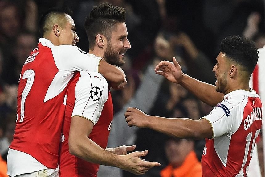 Olivier Giroud (centre) with Alexis Sanchez (left) and Alex Oxlade-Chamberlain after scoring the first goal against Bayern Munich on Wednesday. Giroud and Theo Walcott are both in stellar form for Arsene Wenger's team.