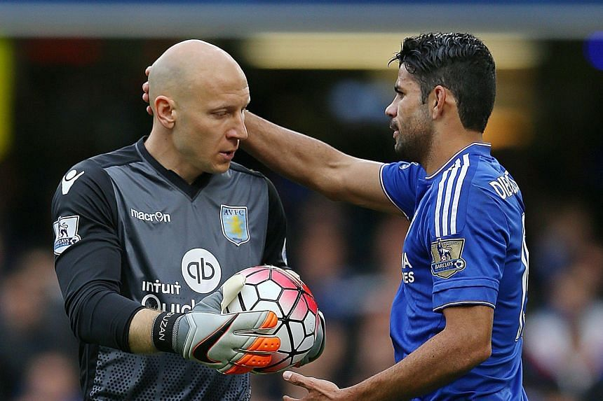Chelsea striker Diego Costa (right) commiserating with Aston Villa goalkeeper Brad Guzan, after the American's howler let the Brazilian-born Spaniard open the scoring for the Blues in their 2-0 win last Saturday.