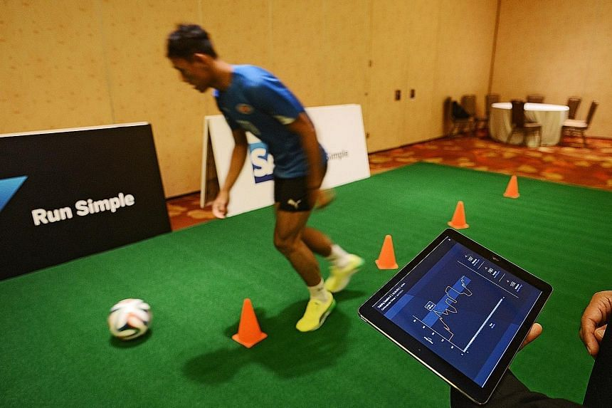 Home United goalkeeper Zulfairuuz Rudy demonstrating SAP's Injury Risk Monitor for the first time in South-east Asia at the software company's regional media summit yesterday.