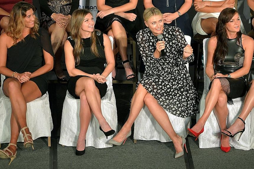 With Serena Williams, winner of the last three WTA Finals titles out, world No. 2 Simona Halep (second from left) and No. 3 Maria Sharapova (with microphone) are the favourites. With them are Garbine Muguruza (left) and Agnieszka Radwanska.