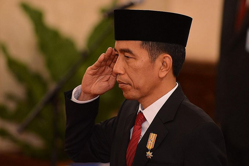 Indonesian President Joko Widodo attending a swearing-in ceremony for newly appointed ministers in Jakarta in August. He will begin his maiden visit to the US tomorrow.