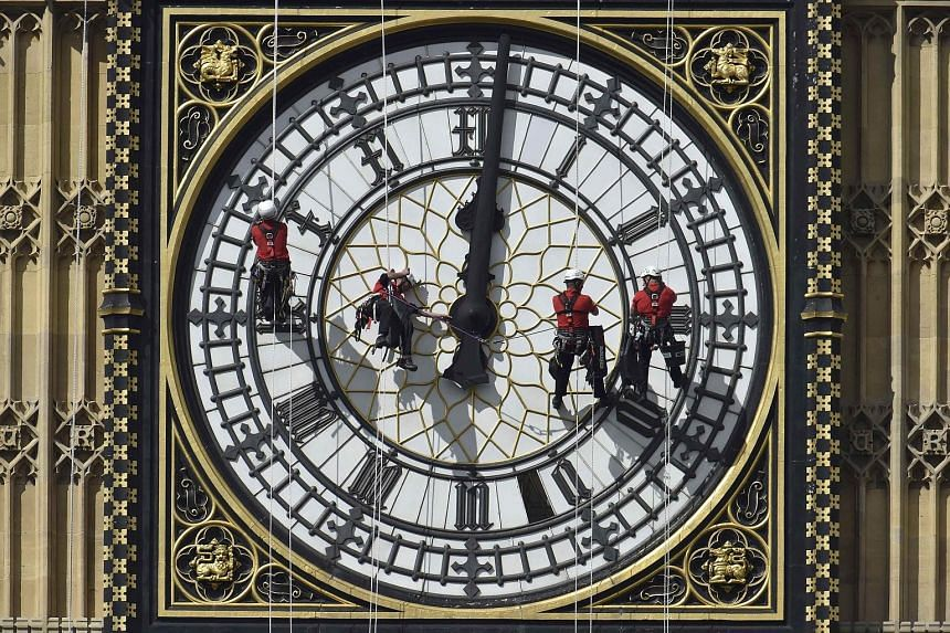 Cleaners at work on Big Ben's clock face last year. Both the clock and tower are now in dire need of repair, which could cost taxpayers £29.2 million (S$62.6 million).