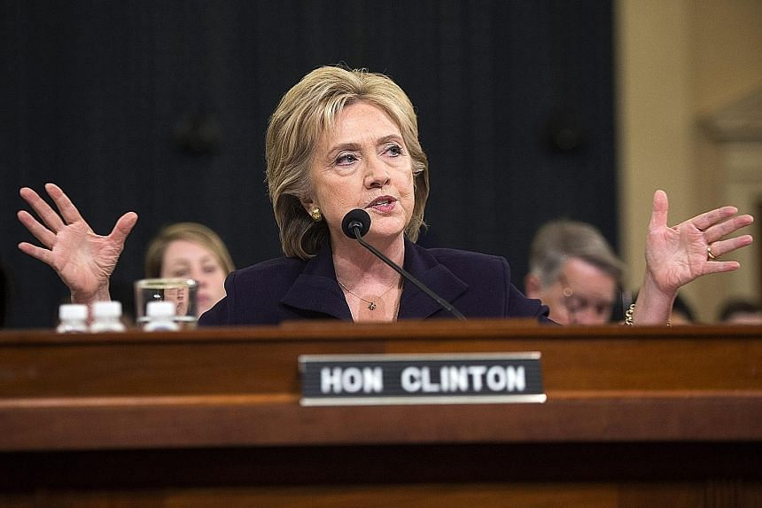 """Mrs Clinton appearing before the House Select Committee on Benghazi on Thursday. Denying longstanding Republican allegations that she turned down requests to beef up security in Benghazi, she said: """"I was not responsible for specific requests and sec"""