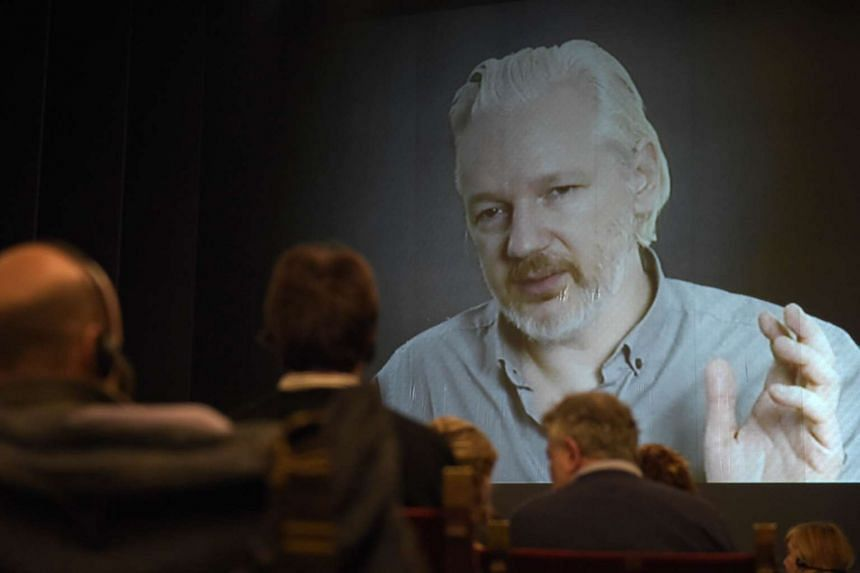 Wikileaks founder Julian Assange onscreen at a conference in September 2015.
