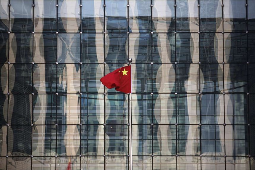 A Chinese flag flies at the headquarters of a bank in central Beijing in 2014.