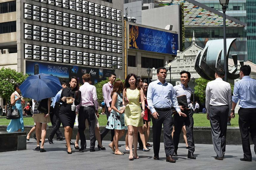 Office workers at Raffles Place on June 16, 2014.
