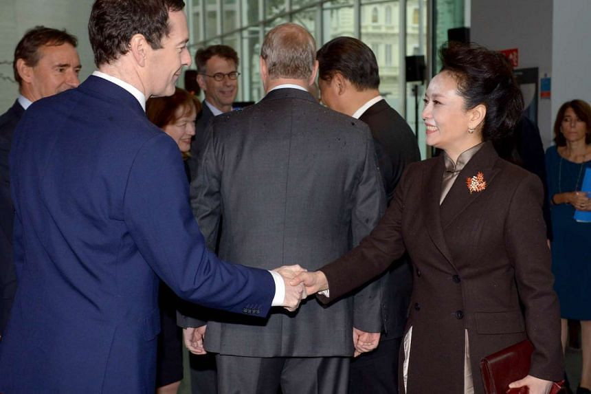 British Chancellor of the Exchequer George Osborne (left), greets Madam Peng at Imperial College London.