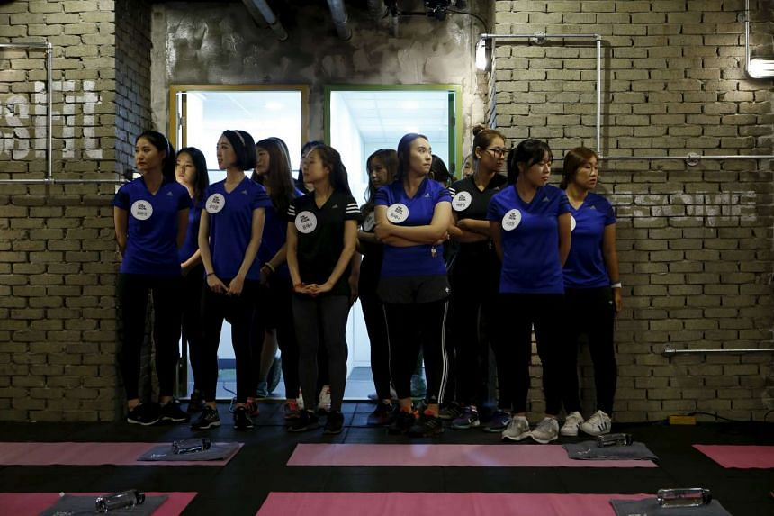 Participants gather before the start of a workout session during the TV programme The Body Show at a gym in Seoul on Sept 19, 2015.