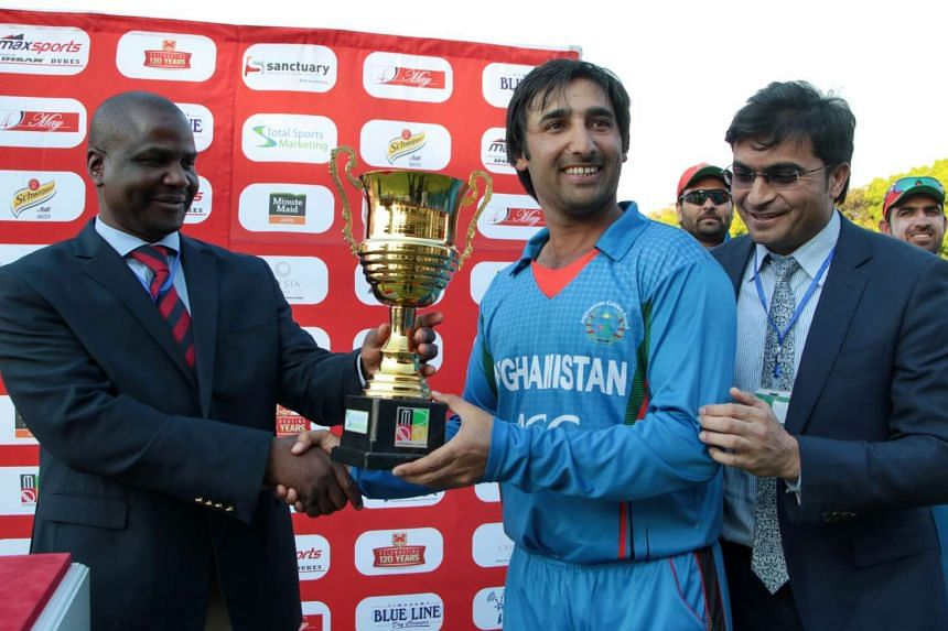 Afghanistan's captain Mohammad Asghar Stanikzai poses with the series trophy after Afghanistan won the fifth and final One Day International (ODI) cricket match against Zimbabwe at the Queens Sports Club, in Bulawyo on Oct 24, 2015.