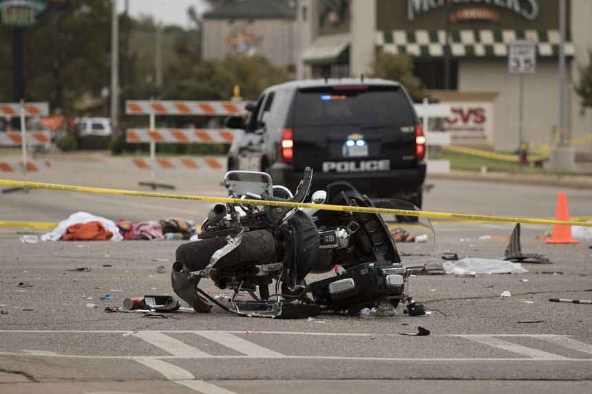 A wrecked police motorcycle lays on the scene after a suspected drunk driver crashed into a crowd of spectators during the Oklahoma State University homecoming parade near the Boone Pickens Stadium on Oct 24, 2015 in Stillwater, Oklahoma.