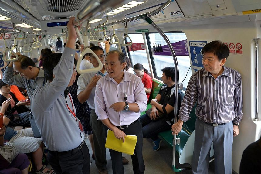 Coordinating Minister for Infrastructure & Minister for Transport Khaw Boon Wan (right) on the train with (foreground left to right) chief executive of LTA  Mr Chew Men Leong and SMRT's director of Station Operations Mr Siu Yow Wee at a ground deploy