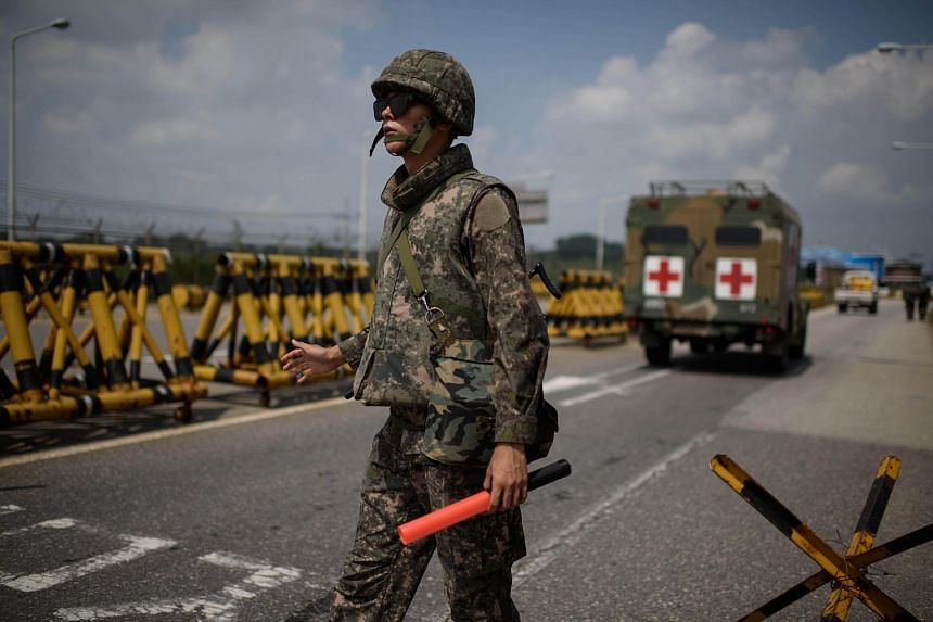A South Korean soldier stands at a checkpoint on the Unification Bridge leading to North Korea near the border village of Yeoncheon in the Demilitarized Zone on Aug 22, 2015.