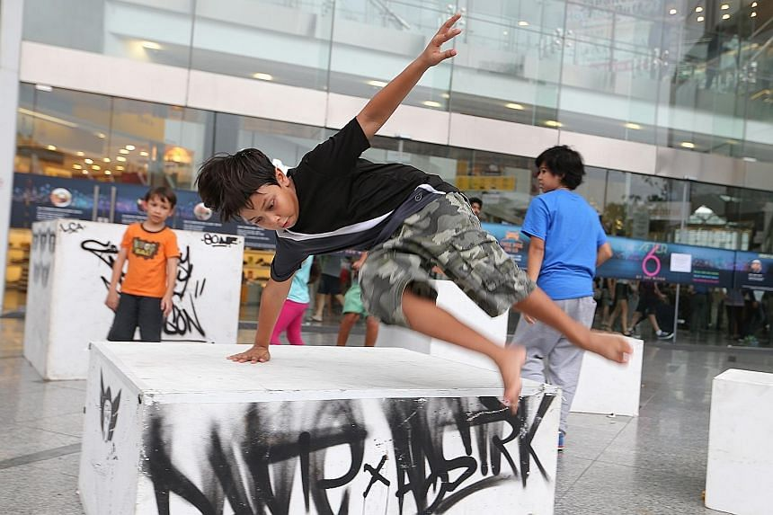 Amir Shah Hromatka, 10, at a parkour workshop by Superfly Monkey Dragons.