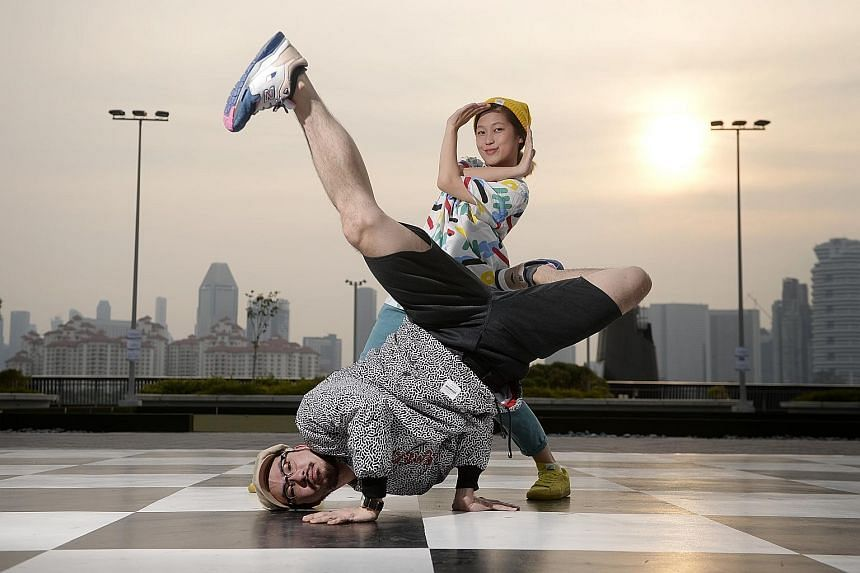 Mr Marcus Tan, 30, and Ms Rachel Lee, 26, at their favourite spot in Singapore - a life-size chess board at the Sports Hub.