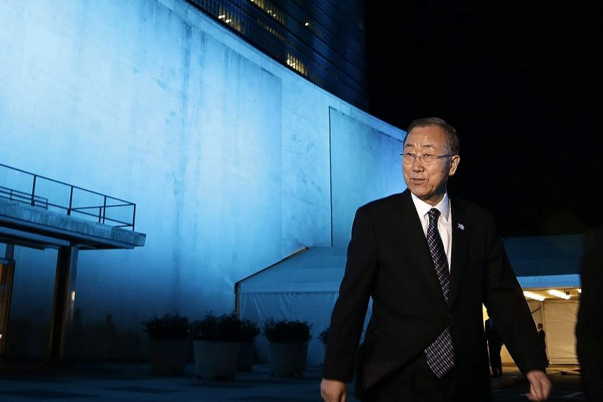 United Nations Secretary- General Ban Ki Moon in front of the UN General Assembly Hall on Friday to mark the UN's 70th anniversary. To commemorate the milestone yesterday, about 200 landmarks across the world - including six in Singapore - were lit u