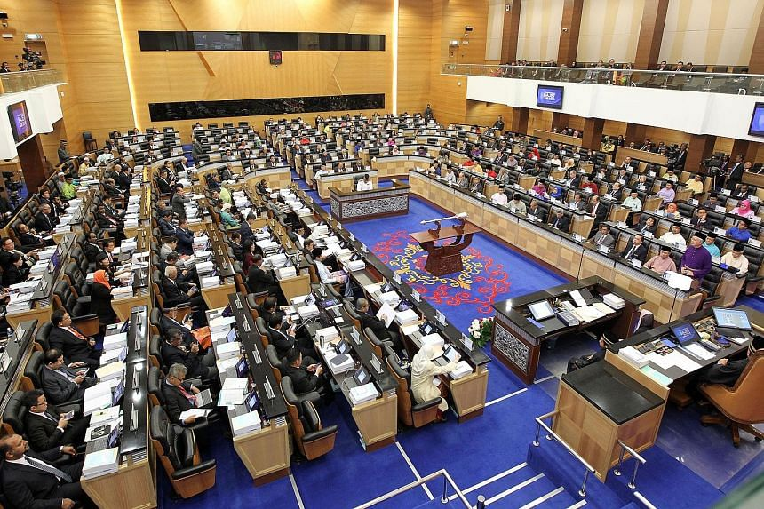 Malaysian Prime Minister Najib Razak (standing on the right, dressed in purple), delivering his Budget speech in Parliament on Friday.