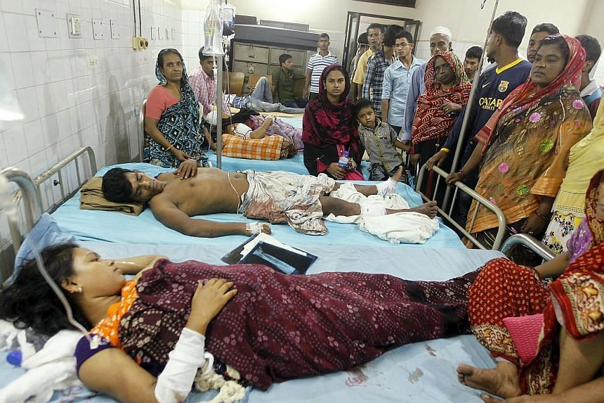 People injured in the blasts in Dhaka recovering in hospital yesterday with relatives gathered around them.